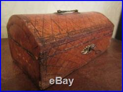 A Georgian leather covered wooden jewellery casket / box