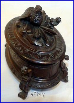 Antique German Black Forest carved wooden bird jewelry box early 1900s with key