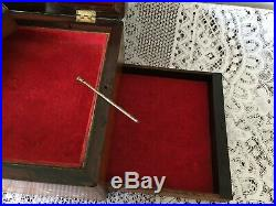 Antique wooden box with mother of pearl inlay with jewellery trays and secret dr